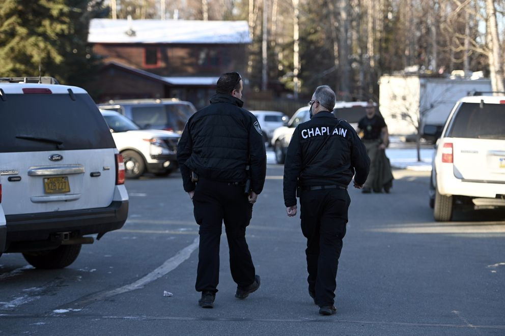 An APD chaplain is on the scene of an officer-involved shooting in Eagle River, October, 22, 2020. (Bill Roth / ADN)