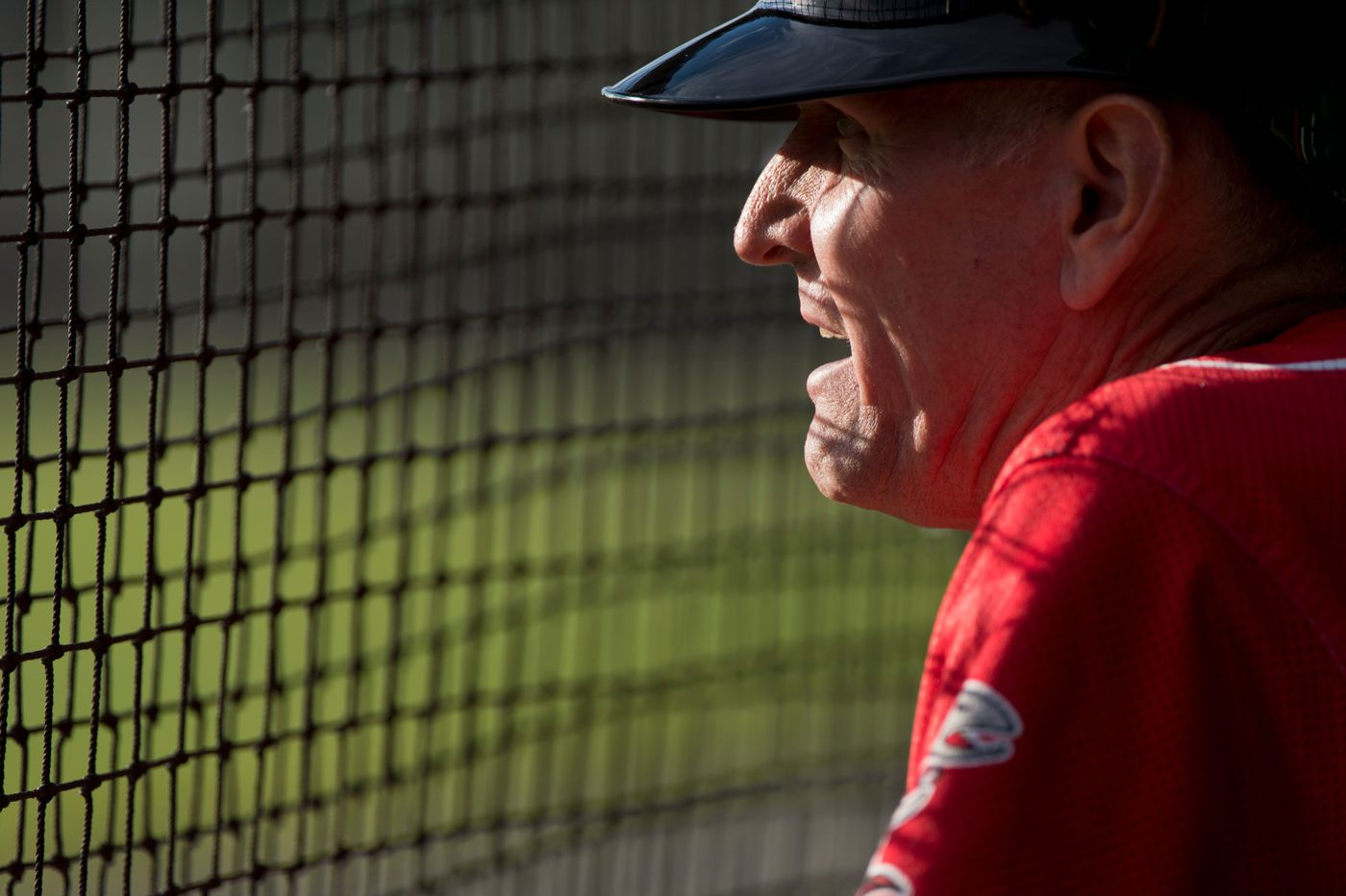 Chinooks head coach Jon Groth talks to his team from the dugout Wednesday. (Marc Lester / ADN)