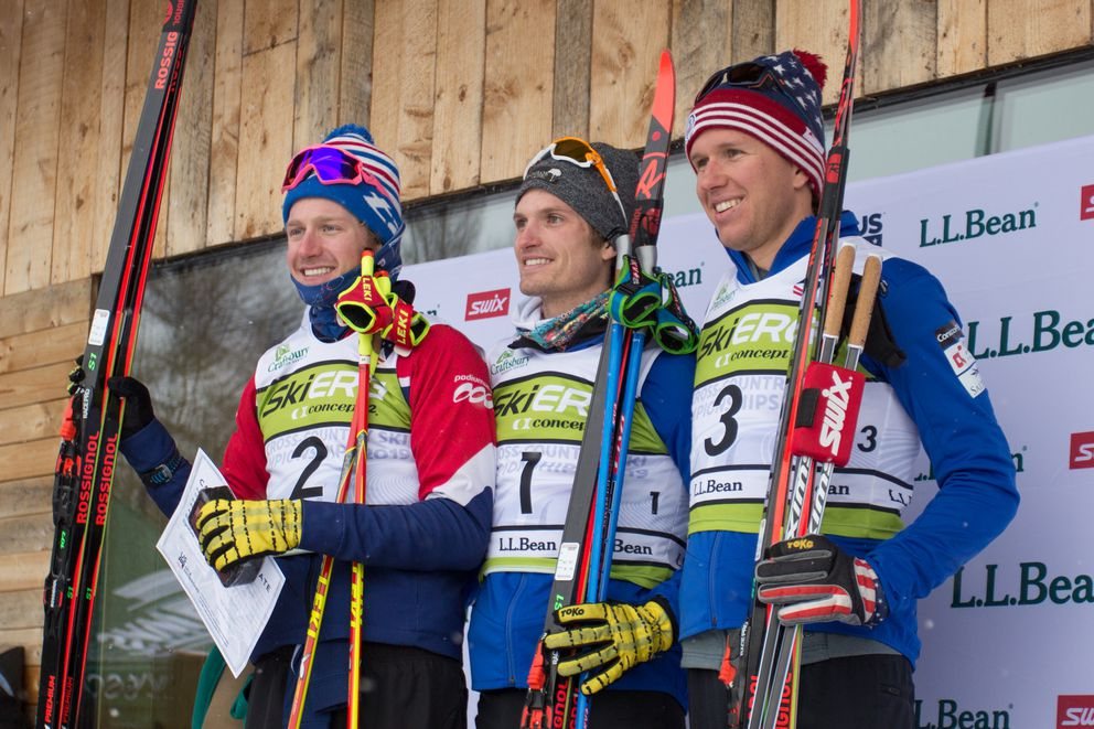 Champion David Norris, center, stands on the podium with second-place Kyle Braturd, left, and third-place Scott Patterson, right, Sunday after the men's 30K freestyle race at the U.S. National Championships in Craftsbury, Vermont. (Photo by Logan Hanneman)