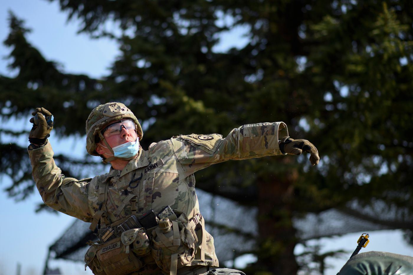 First Lt. Connor Edbauer tosses a grenade replica during testing on April 27, 2021. (Marc Lester / ADN)