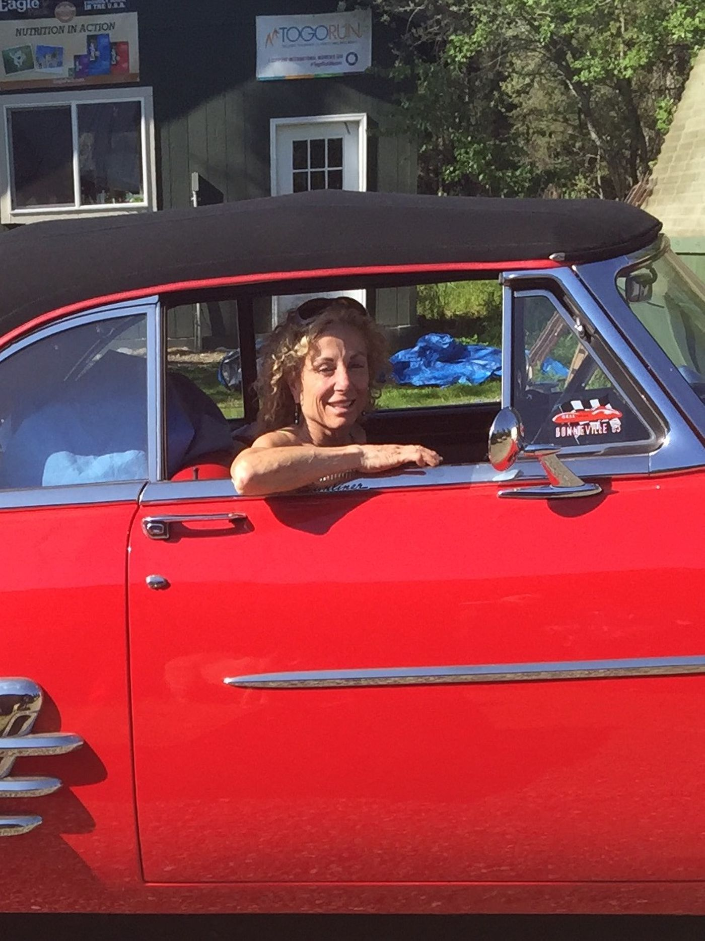 DeeDee Jonrowe and her 1953 Ford cherry red convertible her father left her when he died. Photographed on Saturday, May 30, 2015.