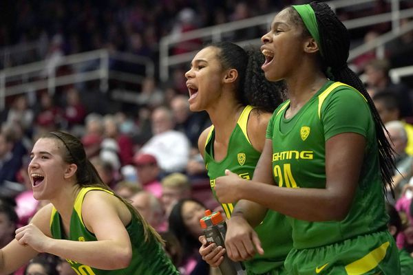 Oregon's Sabrina Ionescu, left, Satou Sabally, center, and Ruthy Hebard celebrate in the last minute against Stanford during the second half of an NCAA college basketball game Sunday, Feb. 10, 2019, in Stanford, Calif. (AP Photo/Tony Avelar)
