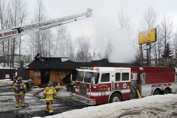 The Anchorage Fire Department responded to an early morning fire at The Bar-B-Q Pit on West Dimond Boulevard on Sunday, March 18, 2018. (Bill Roth / ADN)