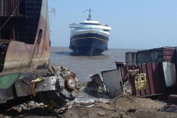 The M/V Taku, which served as a ferry in Alaska for more than a half-century, sits aground at high tide in April, 2018 in Alang, India, where it's set to be dismantled for scrap and recycling. The state sold the Taku for $171,000 earlier this year to Jabal Al Lawz Trading Est., which is based in Dubai and sailed the ship across the Pacific. (Ben Evans / Jabal Al Lawz Trading Est.)