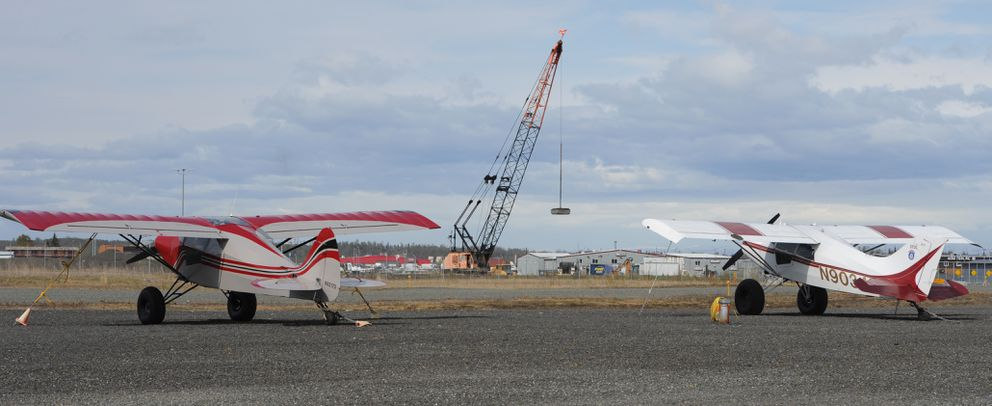 Construction work continues on the Quebec Apron at Merrill Field Airport as viewed from the gravel / ski strip on Tuesday, May 7, 2019. (Bill Roth / ADN)