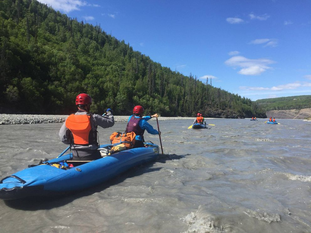 Inflatable canoes like this oneare the boats that Alaska Alpine Adventures uses on their Kongakut River trip. The personal flotation devices are also the same.This photo was made on the Matanuska River. (Photo courtesy Alaska Alpine Adventures)