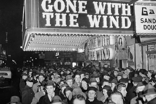 FILE - In this Dec. 19, 1939 file photo, a crowd gathers outside the Astor Theater on Broadway during the premiere of