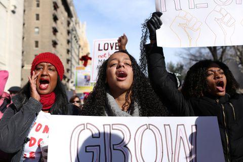 Women cheer at the Women's March in Manhattan in New York City, New York, U.S., January 20, 2018. REUTERS/Gabriela Bhaskar