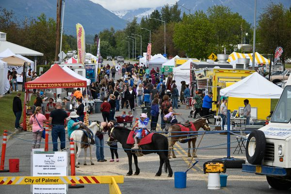 Craft and food vendors and their customers gather on South Valley Way in Palmer for the Friday Fling event on June 26. The Valley Freedom Festival, to be held in Palmer over two days in celebration of the Independence Day holiday, sprang up after Wasilla canceled its traditional Fourth of July celebration. (Marc Lester / ADN)