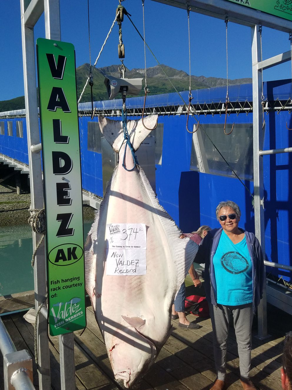 Frieda Wiley, of Valdez, pulled in a record 374 pound halibut during Valdez's Halibut Derby, Sunday, August 6, 2017. (Valdez Fish Derbies)