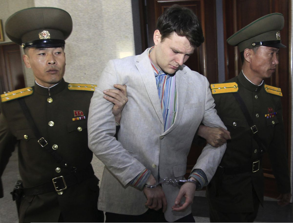 American student Otto Warmbier is escorted at the Supreme Court in Pyongyang, North Korea, on March 16, 2016. (AP Photo/Jon Chol Jin)