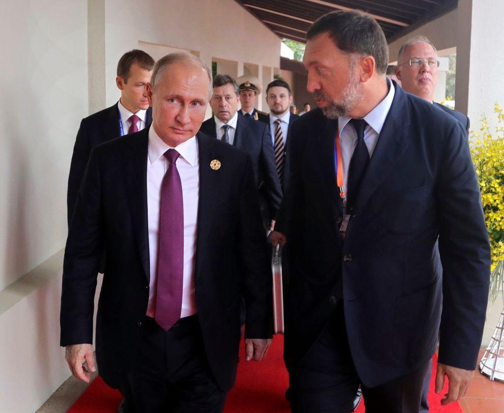 In this Nov. 10, 2017, photo, Russia's President Vladimir Putin, left, and Oleg Deripaska, right, attend the APEC Business Advisory Council dialogue in Danang, Vietnam. (Mikhail Klimentyev, Sputnik, Kremlin Pool Photo via AP, File)