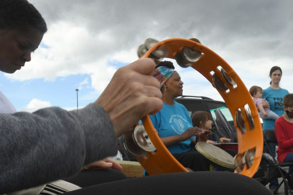 Gail Jackson is framed in a tambourine as she leads a drum circle at the Juneteenth Celebration at the Northway Mall in Anchorage, AK, on Saturday, June 19, 2021. Juneteenth, celebrating the end of slavery in the country, was recently made a national holiday. (Bob Hallinen Photo)