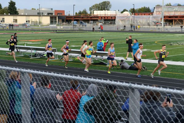 Runners attempt to break four minutes in the mile at the first race of The Great Alaska Mile Series 2017 on Wednesday evening, September 13, 2017, at West. Kyle Merber and Ben Blankenship each ran under four minutes, the first time runners had broken the barrier outdoors in Alaska. The series concludes with another mile race Saturday in Kodiak. (Erik Hill / Alaska Dispatch News)