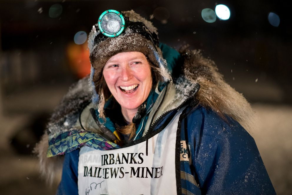 Paige Drobny smiles after finishing the Yukon Quest International Sled Dog Race in Fairbanks on Feb. 12. (Marc Lester / ADN)