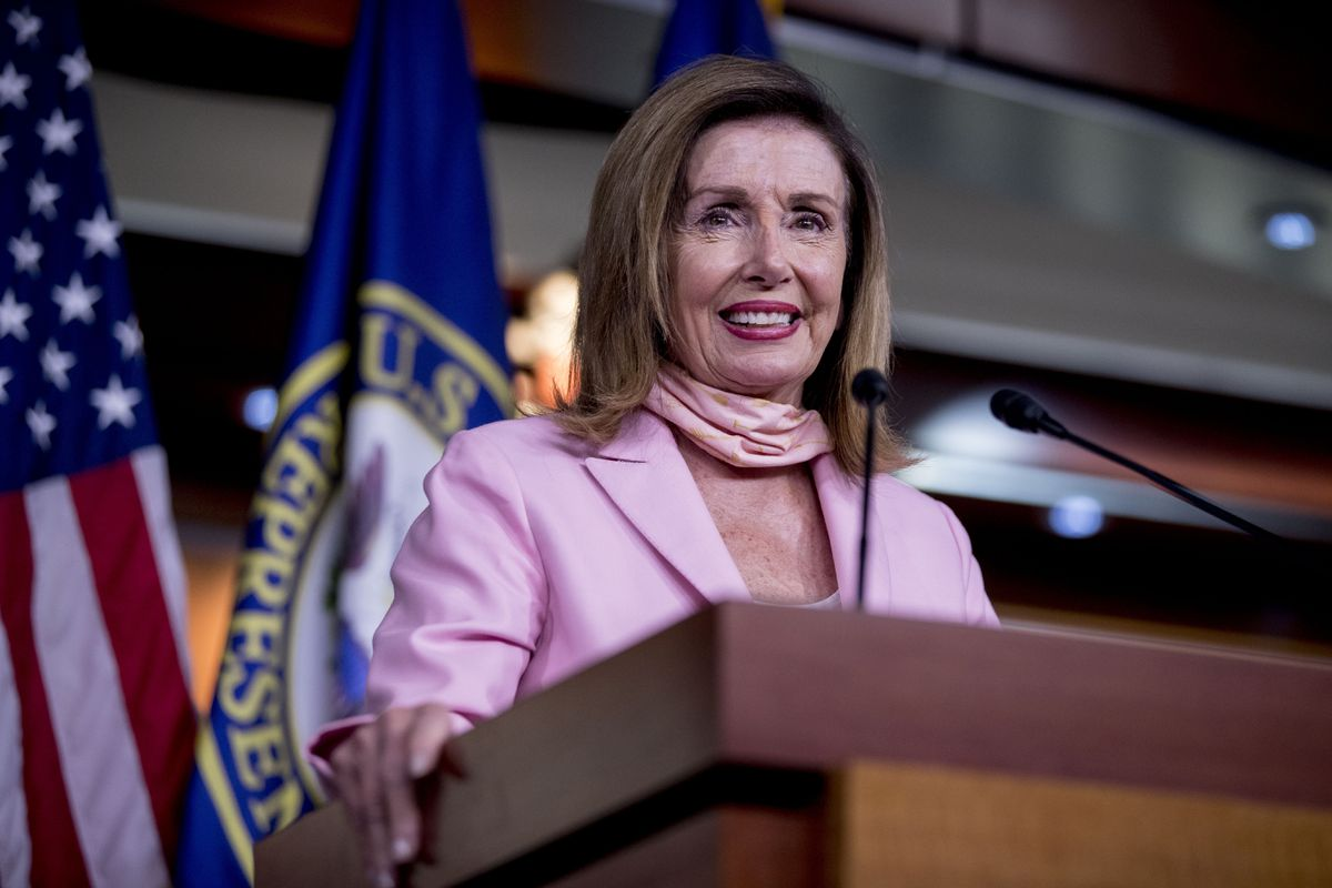 House Speaker Nancy Pelosi of Calif. smiles while speaking at a news conference on Capitol Hill in Washington, Friday, July 31, 2020. (AP Photo/Andrew Harnik)