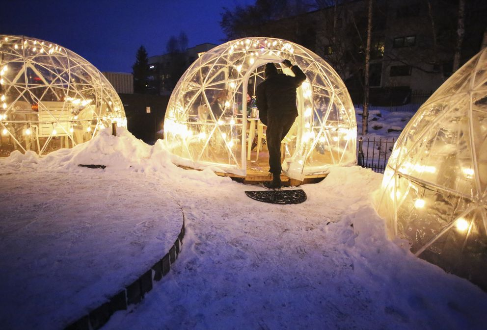 Timothy Watson takes an order from people in one of the PubHouse restaurant's outdoor dining domes at the Inlet Tower in Anchorage on Saturday, Nov. 28, 2020. (Emily Mesner / ADN)