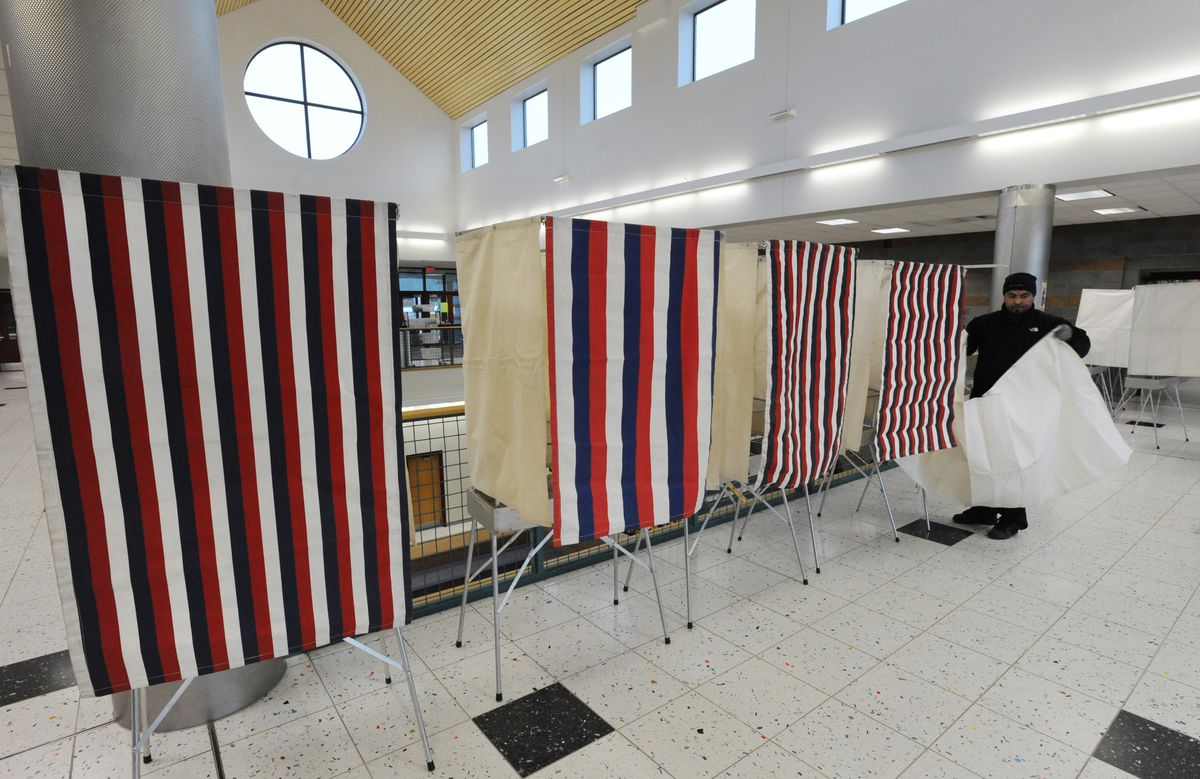 Voting booths being set up at Goldenview Middle School on Monday, Nov. 7, 2016, in preparation for Election Day. (Bill Roth / ADN archive)