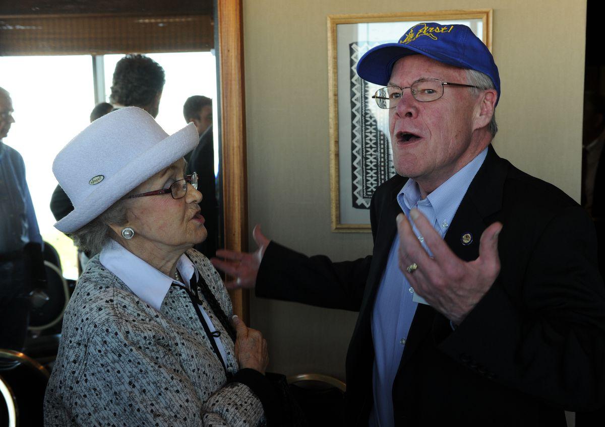 Ermalee Hickel talks with Sen. Dennis Egan at a 2012 news conference. (Bob Hallinen / ADN)