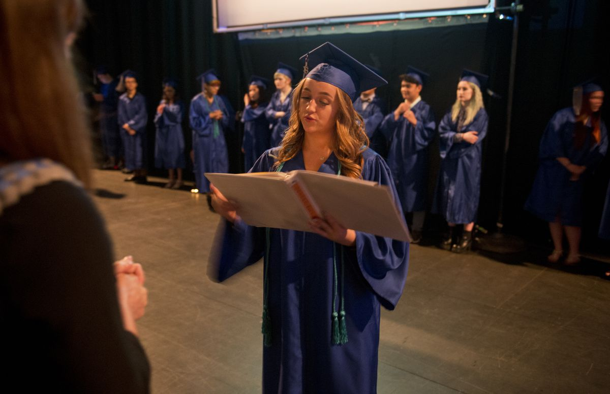 Faron Schneider, 19, reads a graduation speech she wrote but ultimately decided not to give at her graduation ceremony. S.A.V.E. High School recognized 51 graduates at a ceremony at the Alaska Center for the Performing Arts on Tuesday. (Marc Lester / ADN)