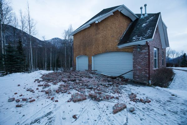 Brick siding from a house lays in a driveway in Eagle River on Saturday morning, Dec. 1, 2018. The house was damaged during a strong earthquake that shook southcentral Alaska on Friday. (Loren Holmes / ADN)