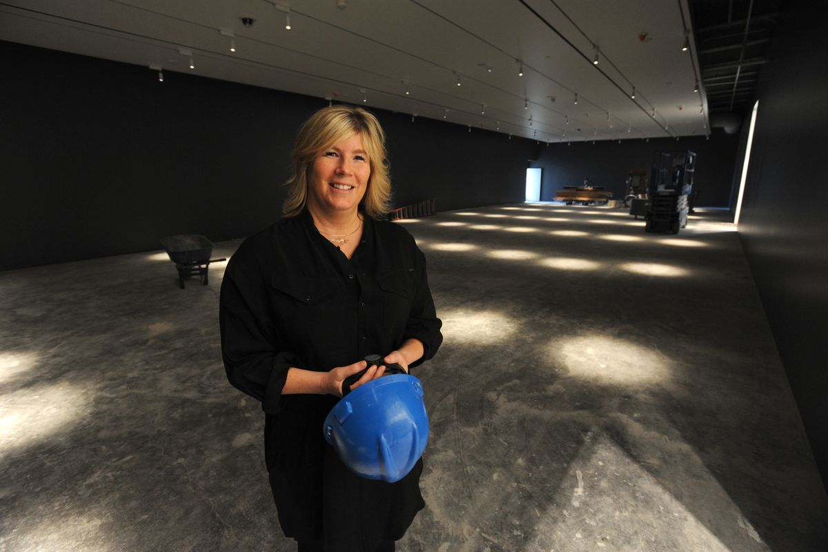 Executive director and CEO Julie Decker stands in a gallery that will display early 20th century landscape paintings by Sydney Laurence, Eustace Ziegler and others in the new Art of the North wing at the Anchorage Museum on Wednesday. (Erik Hill / Alaska Dispatch News)