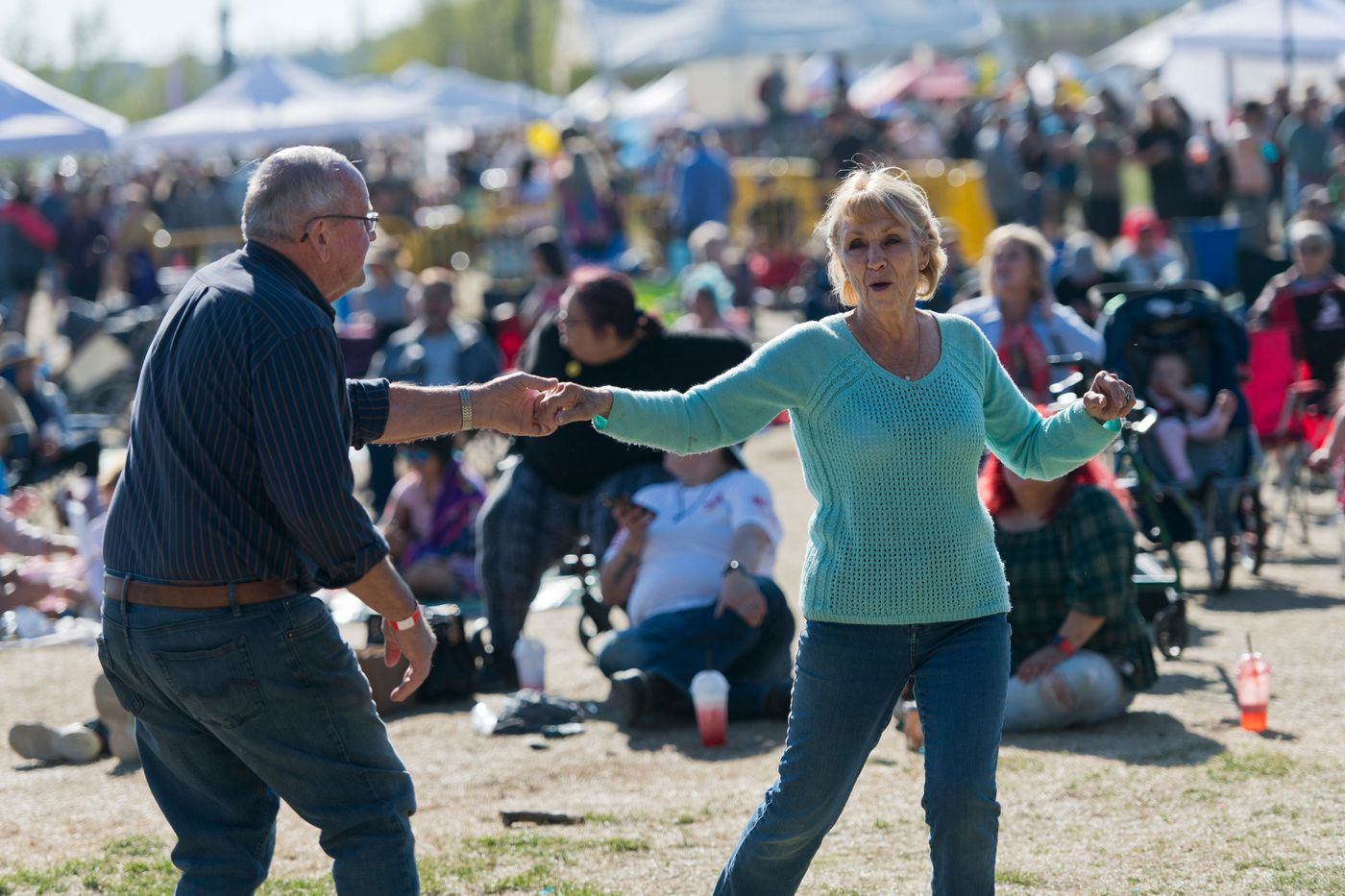 A couple dances at the first Party in the Park live music event of the season at Soldotna Creek Park. (Marc Lester / ADN)