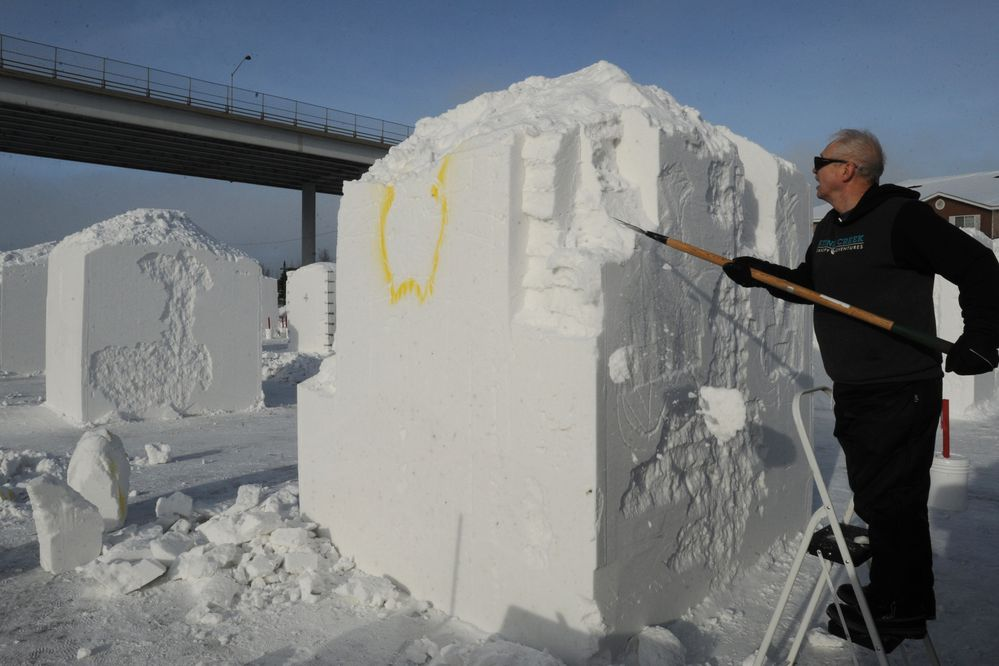 Guy Urban chips away at an 8x8x8-foot block of snow on Monday, Feb. 19, 2018, while competing in the Solo division of the Alaska State Snow Sculpture Championship, presented by BP, at Ship Creek Avenue across from the Comfort Inn. Judging of the Fur Rondy event takes place at 10 a.m. on Sunday. Team of Three division winners will represent Alaska at the U.S. Nationals. Admission is free and folks are encouraged to vote for the People's Choice Award. Rondy begins on Friday, Feb. 23 and runs through Sunday, Mar. 4. (Bill Roth / ADN)