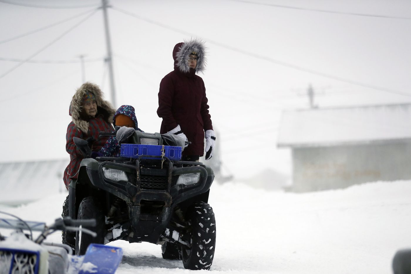 A family prepares to leave after services at the St. Peter Fisherman Church, Sunday, Jan. 19, 2020, in Toksook Bay, Alaska. The first Americans to be counted in the 2020 Census starting Tuesday, Jan. 21, live in this Bering Sea coastal village. The Census traditionally begins earlier in Alaska than the rest of the nation because frozen ground allows easier access for Census workers, and rural Alaska will scatter with the spring thaw to traditional hunting and fishing grounds. (AP Photo/Gregory Bull)