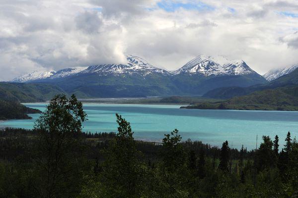 Sunlight illuminates the turquoise glacier-fed water of Skilak Lake on the Kenai Peninsula on Sunday, June 11, 2017. (Bill Roth / Alaska Dispatch News)