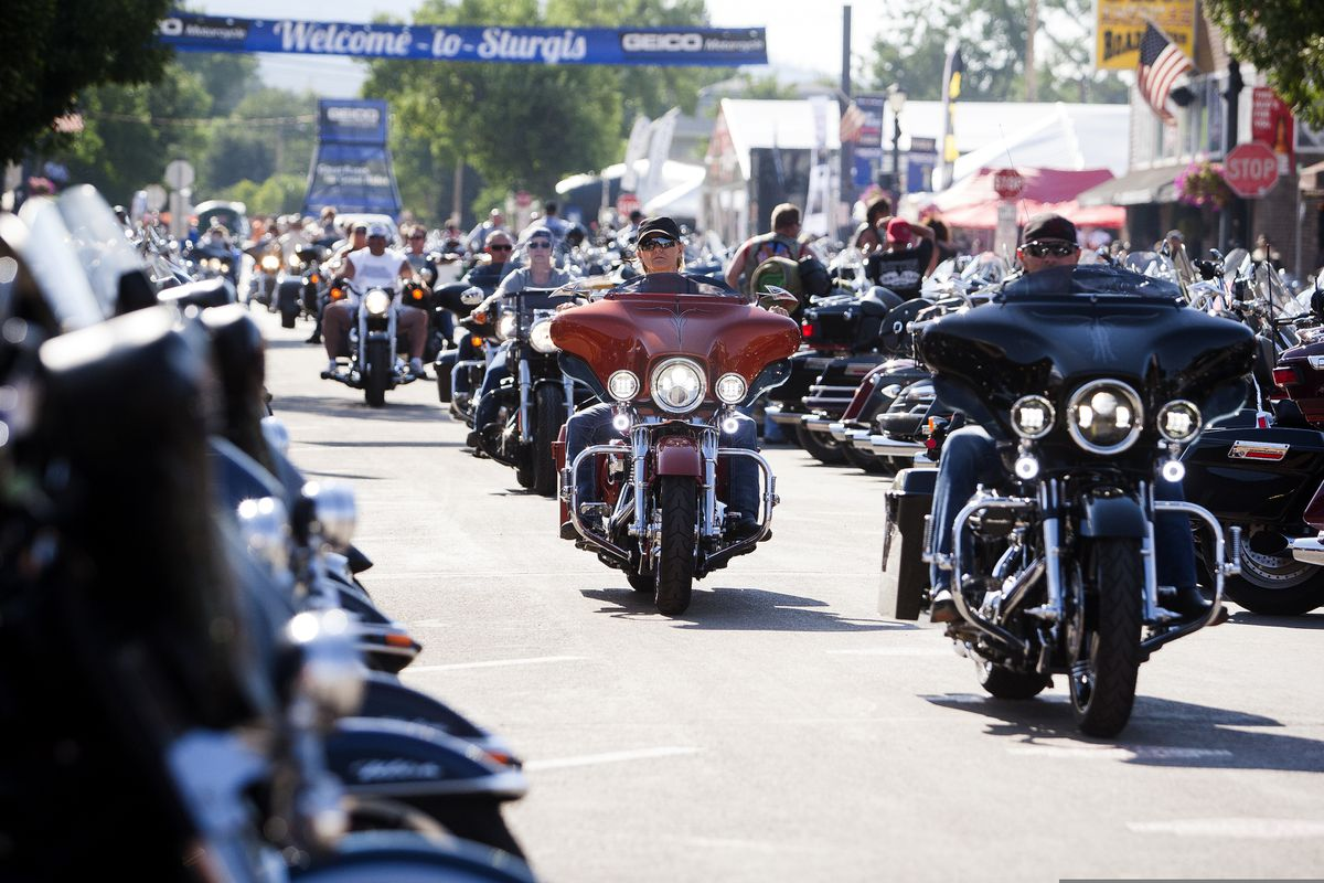 FILE - In this Aug. 5, 2016 file photo, bikers ride down Main Street in downtown Sturgis, S.D., before the 76th Sturgis motorcycle rally officially begins. (Josh Morgan/Rapid City Journal via AP, File)