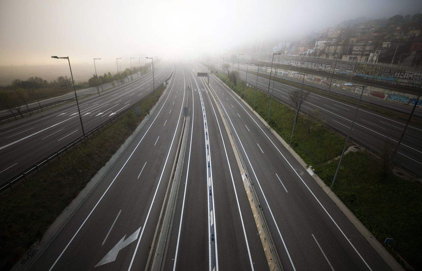 The highway leading to Barcelona is seen empty of cars on Sunday, March 15, 2020. Spain's government announced Saturday that it is placing tight restrictions on movements and closing restaurants and other establishments in the nation of 46 million people as part of a two-week state of emergency to fight the sharp rise in coronavirus infections. (AP Photo/Emilio Morenatti)