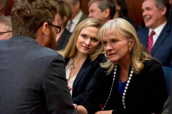 Donna Walker, wife of Gov. Bill Walker, greets Rep. Justin Parish, D-Juneau. The Alaska Legislature works at the Captiol in Juneau on January 18, 2017. (Marc Lester / Alaska Dispatch News)