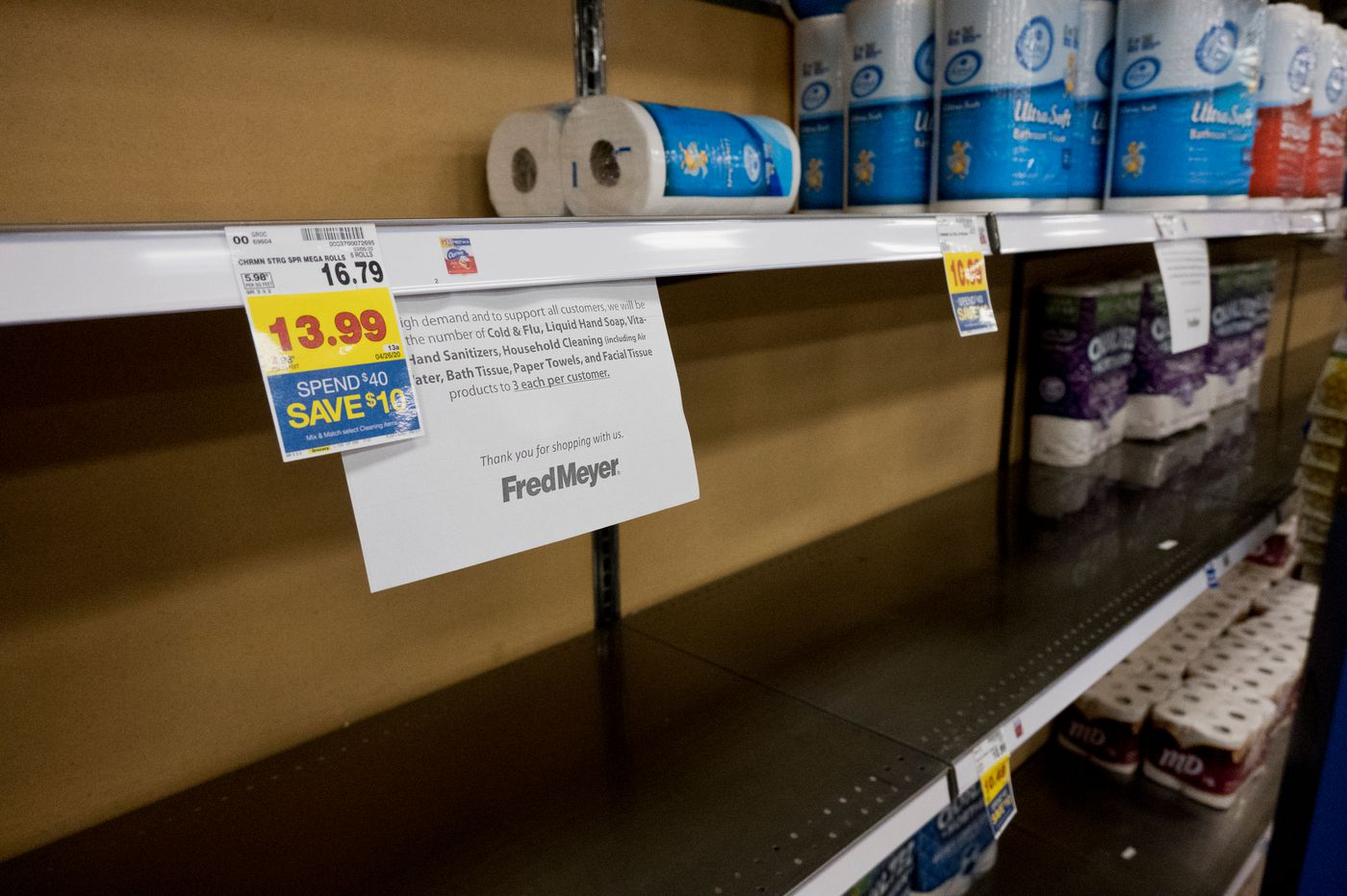 A sign in Fred Meyer in Midtown Anchorage explains the story policy limiting the quantity of certain products that customers can buy, including toilet paper, on March 13, 2020. (Marc Lester / ADN)