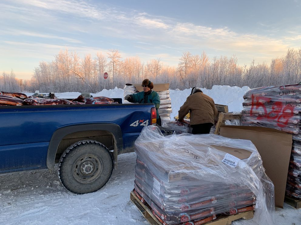 A donation of 39,000 pounds of dog food from Purina arrives in Tanana in November 2020 to help feed sled dog teams through the winter. (Courtney Agnes)