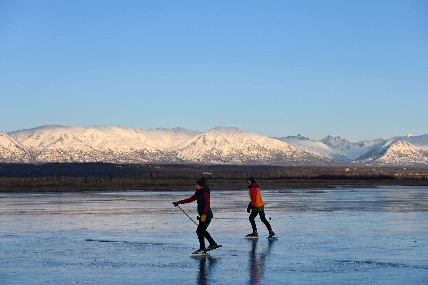 Sunlight reaches the Talkeetna Mountains in this view from frozen lagoons on Palmer Hay Flats State Game Refuge. (Marc Lester / ADN)