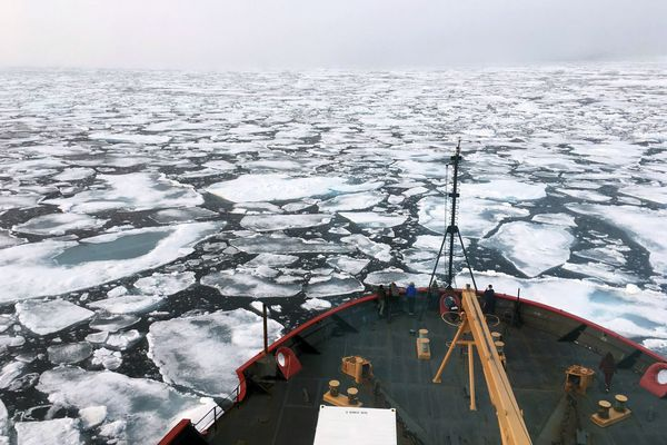 FILE - This summer 2018 file photo provided by the National Oceanic and Atmospheric Administration shows the U.S. Coast Guard Icebreaker Healy on a research cruise in the Chukchi Sea of the Arctic Ocean. President Donald Trump's plan to reverse environmental initiatives in Alaska put in place by his predecessor, Barack Obama, took a hit with two rulings in federal court. U.S. District Court Judge Sharon Gleason on Friday, March 29, 2019 ruled that ruled that Trump exceeded his authority when he reversed bans on offshore drilling in vast parts of the Arctic Ocean and dozens of canyons in the Atlantic Ocean. She also ruled that the administration violated federal law with a proposed road that would split a wilderness area in a national wildlife refuge. (Devin Powell/NOAA via AP, File)
