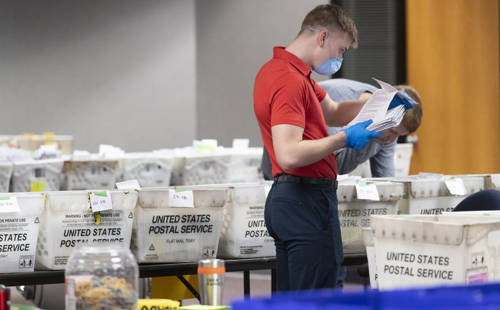 In this April 8, 2020 file photo, a City of Milwaukee Election Commission worker processes and sorts absentee ballots for Wisconsin's primary election, in downtown Milwaukee, Wis. (Mark Hoffman/Milwaukee Journal-Sentinel via AP, File)