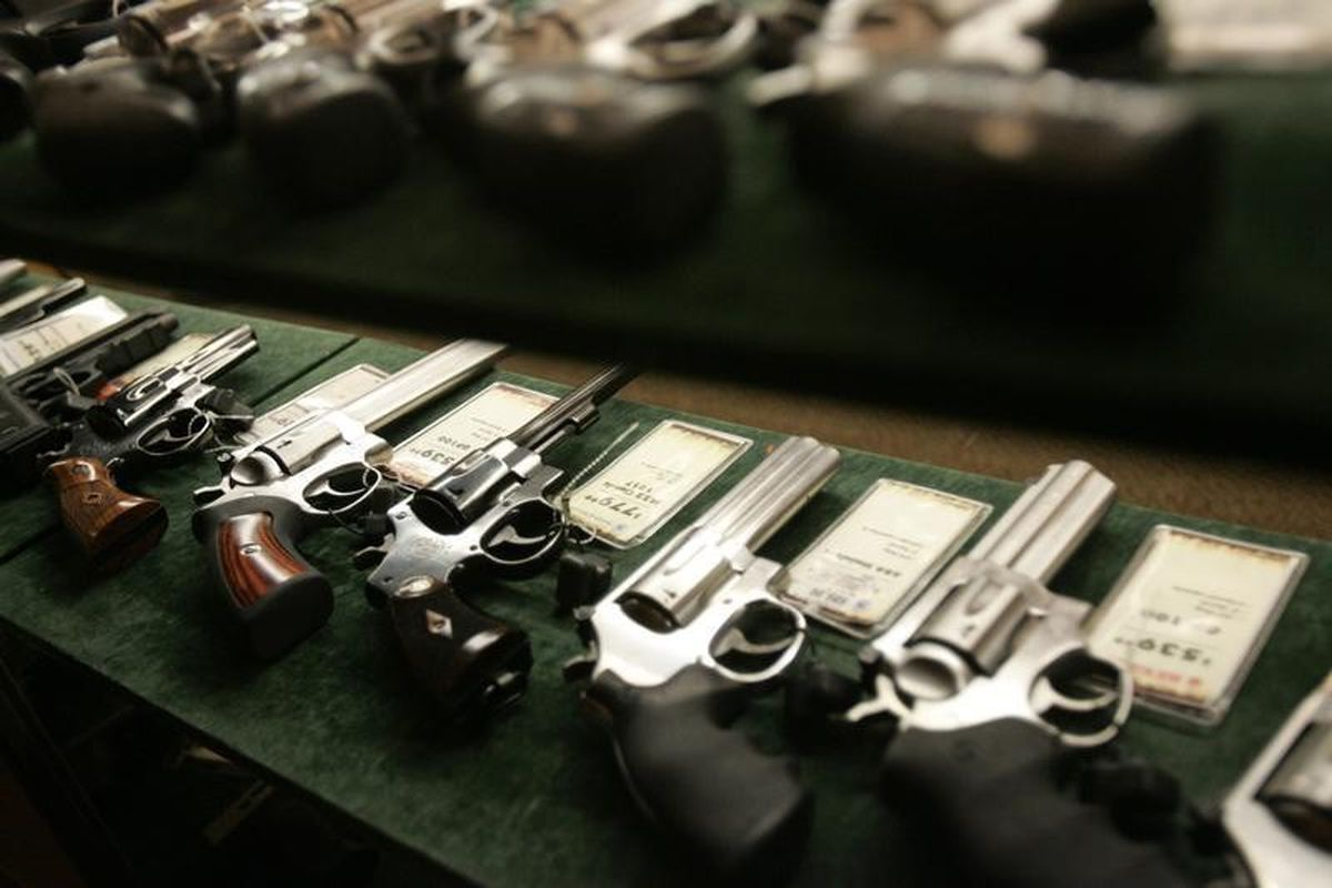 Guns are seen inside a display case at the Cabela's store in Fort Worth, Texas, June 26, 2008. (Jessica Rinaldi / Reuters file)