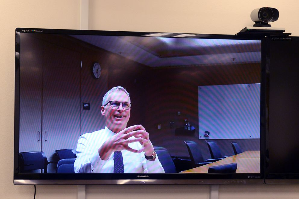 University of Alaska President Jim Johnsen confers via video with Commissioner of Education and Early Development Michael Johnson on Friday, January 13, 2017, in Anchorage. (Erik Hill / Alaska Dispatch News)