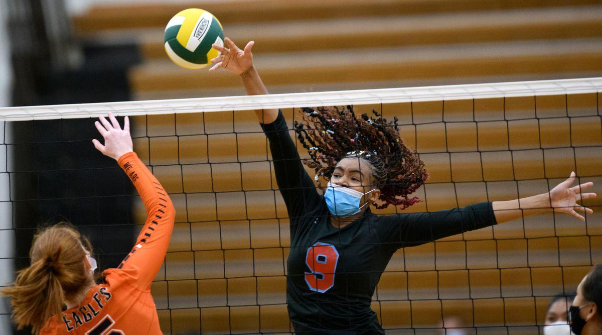 East's Khadijah Morgan tries to block West's Camille Ruhlin-Hicks. (Marc Lester / ADN)
