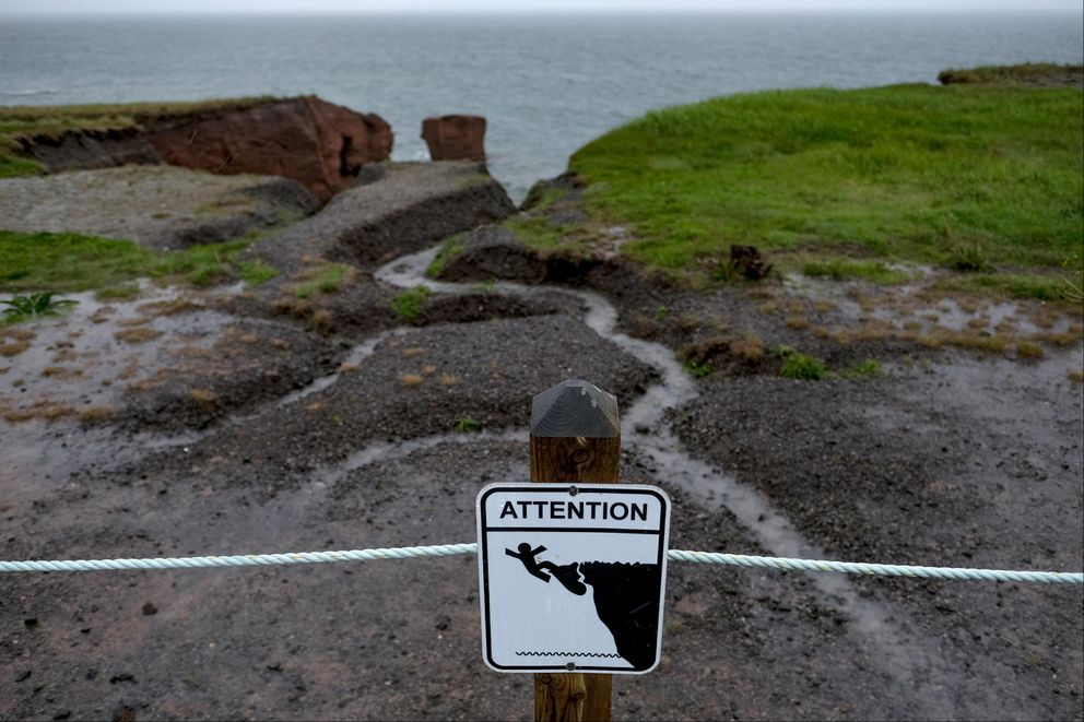 A sign warns about the danger of unstable cliffs. (Washington Post photo by Bonnie Jo Mount)