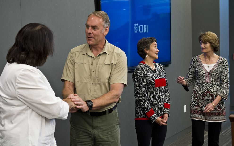 Interior Secretary Ryan Zinke shakes hands with Alaska Federation of Natives president Julie Kitka after a meeting with AFN and Alaska's congressional delegation in May. AFN co-chair Ana Hoffman talks with Sen. Lisa Murkowski at right. (Marc Lester / Alaska Dispatch News)