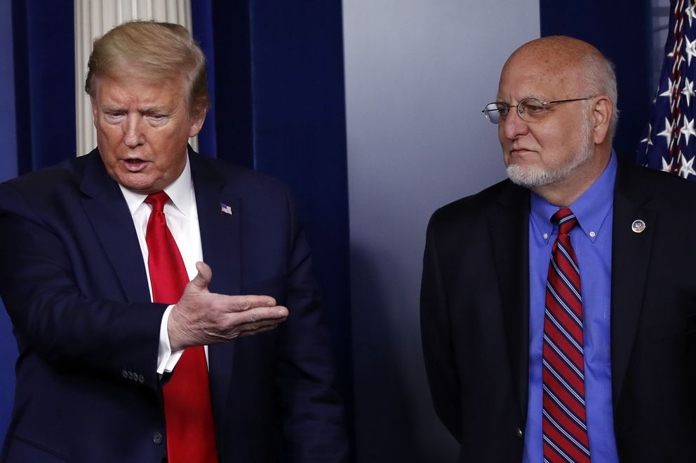 President Donald Trump speaks about the coronavirus in the James Brady Press Briefing Room of the White House, Wednesday, April 22, 2020, in Washington, as Dr. Robert Redfield, director of the Centers for Disease Control and Prevention, listens. (AP Photo/Alex Brandon)