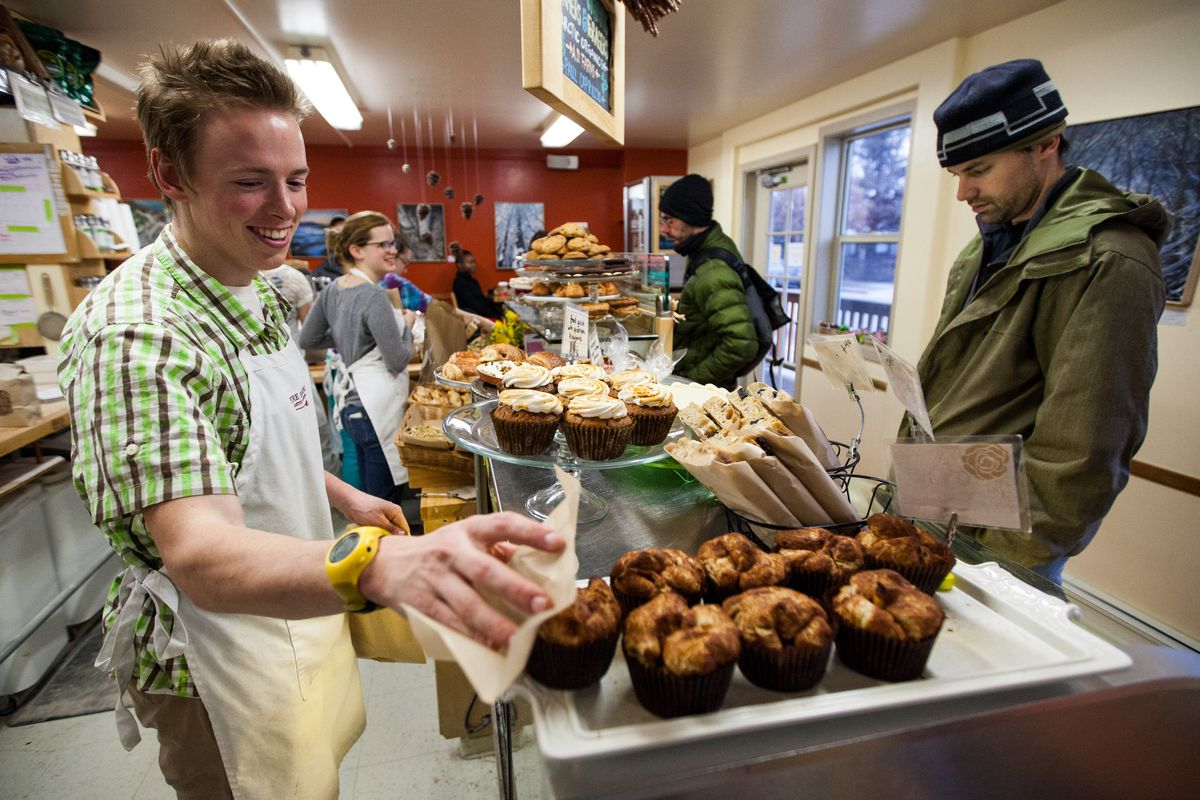 Fire Island bakery staff member Cole Deal helps customer Roman Romanovski with some baked goods.