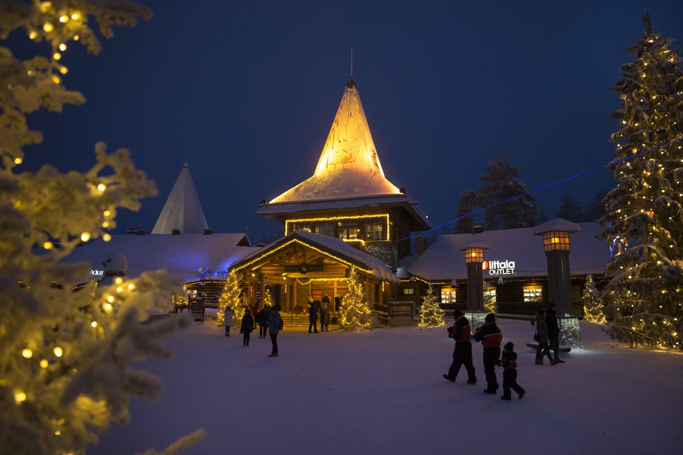 "A dark afternoon at Santa Claus Village in Rovaniemi, Finland, Dec. 18, 2017. This remote city near the Arctic Circle claims to be the ""Official Hometown of Santa Claus,"" and hundreds of thousands visit each year, many from lands like China, with no Christmas traditions. (Ilvy Njiokiktjien/The New York Times)"