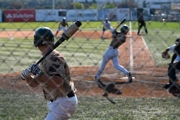 A Mat-Su Miners player waits on deck as a teammate swings in a game against the Anchorage Glacier Pilots at Mulcahy Stadium in Anchorage on June 26, 2019. (Marc Lester / ADN)