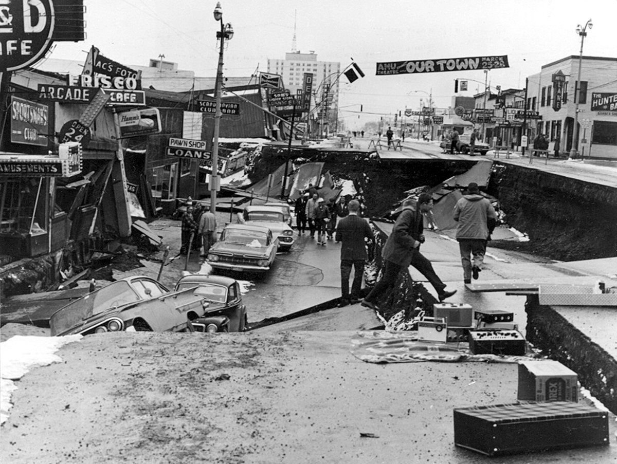 Collapse of Fourth Avenue near C Street in Anchorage, Alaska, due to a landslide caused by the earthquake on March 27, 1964. Before the shock, the sidewalk on the left was at street level on the right. (U.S. Army)