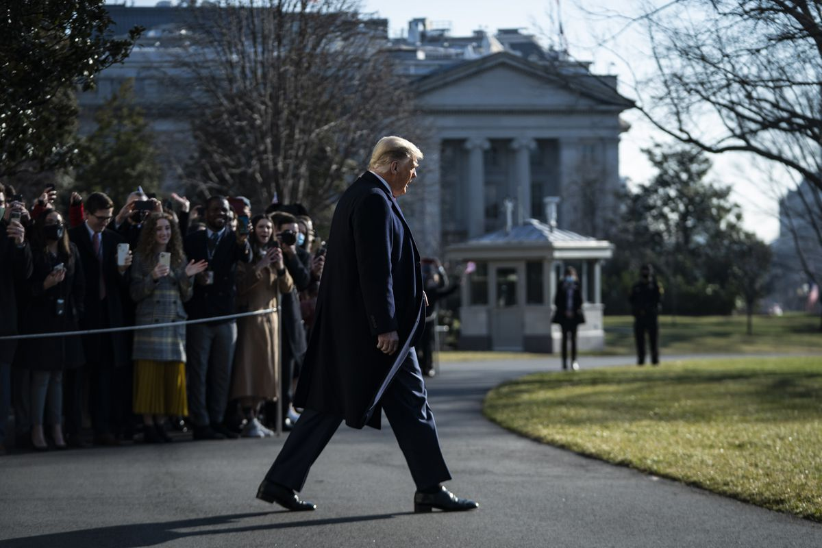President Donald Trump greets visitors and staff members as he walks to board Marine One and depart from the South Lawn at the White House on Tuesday, Jan 12, 2021. (Washington Post photo by Jabin Botsford)