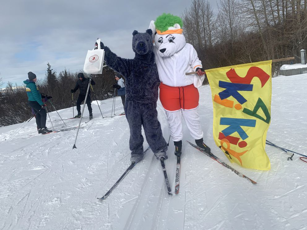 A pair of costumed mascots offer encouragement to participants in the Ski 4 Kids at Kincaid Park. The event runs through Saturday afternoon. (Photo by Maria Witmer)